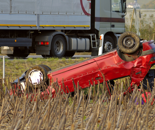 flipped red car crash